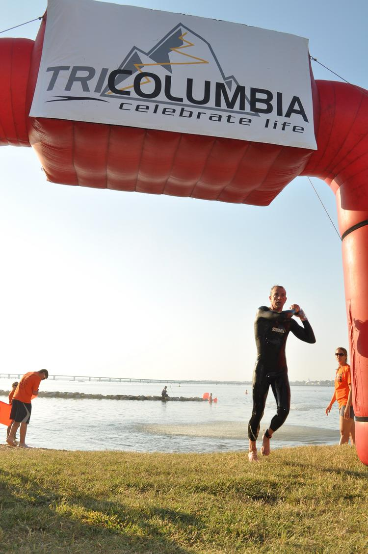 TriColumbia's races will go on as scheduled after athletes worried the company was shuttering.