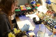 Lisa McGrath, head of the art department, at her work station.