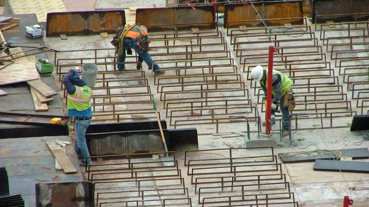 Construction workers at the site of a major development in the Uptown area of Dallas.