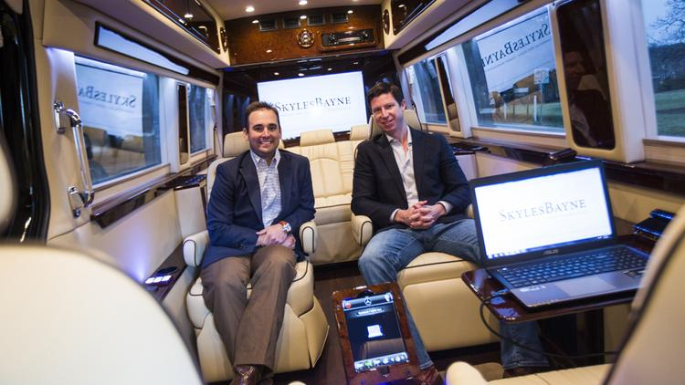 From left, Justin Bayne and Chris Skyles in their $200,000 Mercedes van outfitted for corporate meetings 2014.