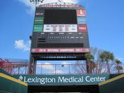 Multimedia rights extend beyond the football stadium, with corporate partner signage seen here at USC's baseball stadium.