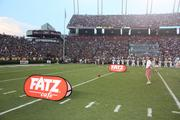 Other options for corporate sponsors that are made possible through IMG College are events integrated into the game itself, like one seen here at field level for Fatz Cafe.