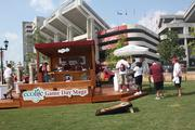 IMG College also sells sponsors the opportunity to interact with fans and get their name out, like a display seen here outside Williams Brice Stadium from sponsor Ecolife Stabilized Weather-Resistant Wood.