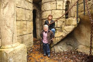 Matt and Amy Roloff pose outside the castle that the couple had constructed on their Washington County farm. 