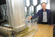 Honolulu Realtor Jack  Tyrell uses an architect's model to show the unit in the Waiea luxury high-rise condominium that he will move into in about two years.