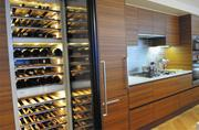 Units feature 106-bottle wine cabinets that retail for $8,000 as standard amenities.