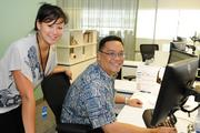 Sandy Wang, left, advertising coordinator and Kevin Yim, director of advertising and promotions, work side by side in the marketing department at Hawaiian Airlines' corporate headquarters in Honolulu.