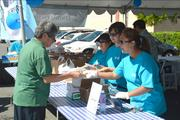 "Central Pacific Bank employees prepare and distribute ""50 cent plate lunches"" at the Kapalama branch to commemorate  the bank's 60th anniversary. A total of 2,100 plate lunches were sold at eight branches statewide."