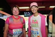 Adm. Cari Thomas, commander, 14th Coast Guard District, and Kelly Hoen, general manager of The Royal Hawaiian hotel are seen after finishing the Kaiser Permanent Great Aloha Run at Aloha Stadium.