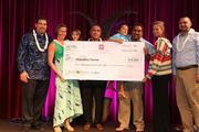 The owners of Mapulehu Farms won third place in the Mahiai Match-Up Agricultural Business Plan contest. From left, Keawe Liu, executive director, Ke Alii Pauahi Foundation, Ane Bakutis, Adolph Helm, Kekamaikaikamaikalani Helm and family members with Kaeo Duarte, right, Kamehameha Schools' West Hawaii director of strategic initiatives.