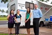 The Walmart Foundation's Hawaii State Giving Council donated $51,813 to buy a new mobile health van, which students at the University of Hawaii John A. Burns School of Medicine use to provide free medical clinics and outreach services for the homeless in Honolulu, Waianae and Kalaeloa. From left are Dr. Jill Omori, medical students Lauryn Ando and Ellyse Tom, and Ray Griego, store manager for the new Downtown Honolulu Walmart.