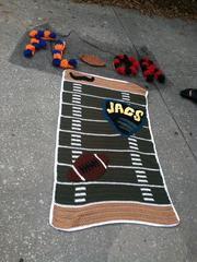 This football crochet will be part of the Jacksonville mural on the fence that surrounds the Laura Street Trio site.
