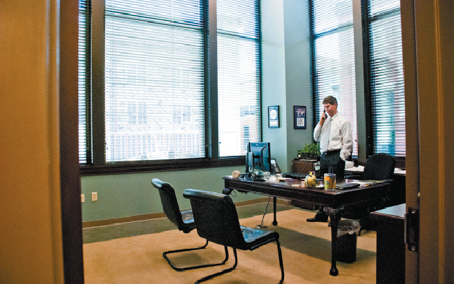 Justin Crosslin, operations principal at Green Hills-based Crosslin & Associates, takes a call in his new office. The firm moved from West End late last year.