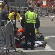 "Emergency responders treated victims of two ""massive"" explosions at the Boston Marathon finish line."