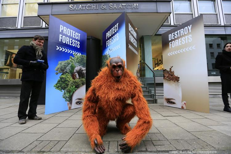 Greenpeace set up a large wooden barricade with two doorways outside the main entrance to Saatchi & Saatchi on Friday. The agency works on advertising for Head & Shoulders, one of the top brands of P&G.