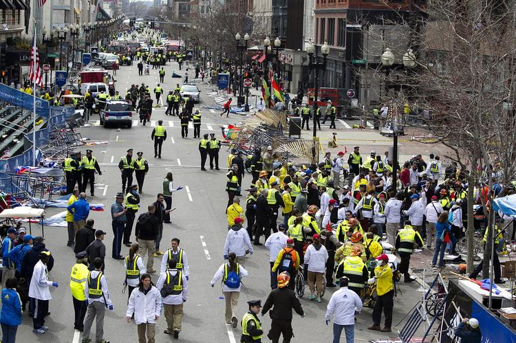Photos from the aftermath of two explosions that hit near the finish line of the Boston Marathon as runners streamed past it, Monday.