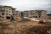 The four-story Bradford apartment buildings will all be interconnected with a large, landscaped plaza area that will also be accessible to customers coming to the Publix grocery store and small shops.