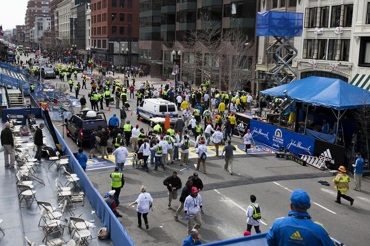 Logan International Airport reopened after closing under an FAA ground restriction, following bomb attacks at the Boston Marathon finish line.