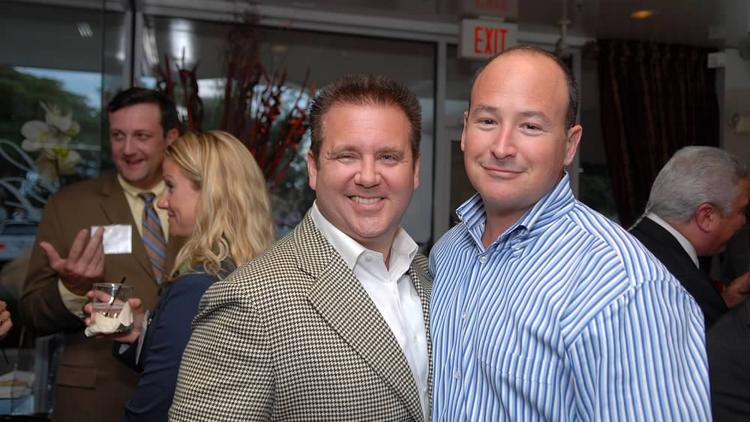 Ponzi schemer Scott Rothstein chums with attorney Russell Adler in 2009 before the Rothstein fraud collapsed. In the background, at left, is Rothstein's primary bank contact at TD Bank, Frank Spinosa.