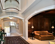 1238 Shepard Oaks Court: The foyer is two stories tall and opens to a paneled library.