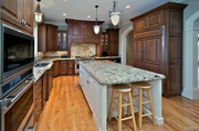 1238 Shepard Oaks Court: The kitchen has cherry cabinets and granite countertops.