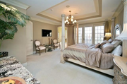 1238 Shepard Oaks Court: The master suite features two walk-in closets. a private deck and a sitting room.