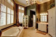 16702 Wills Terrace: The master bathroom features slab marble countertops and a dual-head shower.