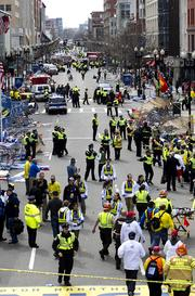 First responders rush to where two explosions occurred along the final stretch of the Boston Marathon on Boylston Street in Boston, Massachusetts, U.S., on Monday, April 15, 2013. Photographer: Kelvin Ma/Bloomberg