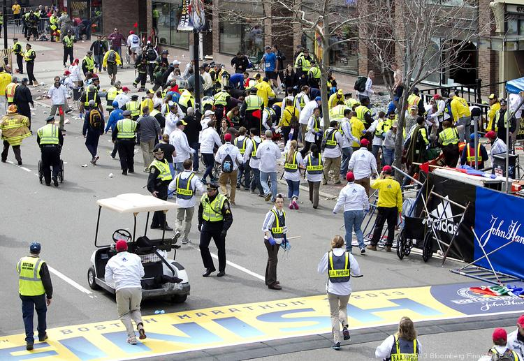 First responders rush to where two explosions occurred along the final stretch of the Boston Marathon on Boylston Street in Boston on Monday. Two powerful explosions rocked the finish line area of the Boston Marathon near Copley Square.