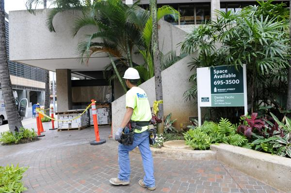 A worker walks to the job site of the new Longs Drugs store at the Davies Pacific Center in Downtown Honolulu. The nearly 9,000 square-foot store will be located along the Merchant Street side of the building, between Bishop and Alakea streets and across from the back of the First Hawaiian Center.