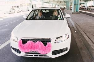 Lyft drivers adorn their vehicles with pink mustaches.