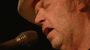 Neil Young performs in a scene from