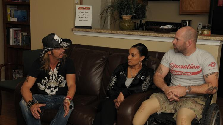 Singer Bret Michaels meets with wounded warrior Stephen Jackel and his wife Adriana at Operation Homefront Village in San Antonio.