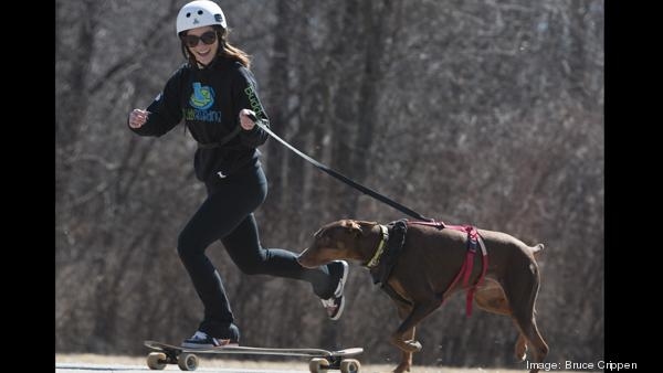 Carly Mellencamp is the creator of Buddy's  Box and Buddy's Boarding. She works out with Dre, her parents' Doberman.