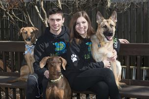 Nick Crotinger, left, is a business partner with girlfriend Carly Mellencamp, right. She created Buddy Box and Buddy Boarding as a part of a project for her graduate course work in public relations. With them from left are dogs Melvin, Dre and Enon.