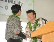 Kevin Sagara, vice president of Renewables and Corporate Development of Sempra U.S. Gas & Power, welcomes Hawaii Lt. Gov. Shan Tsutsui at the dedication Friday of the Auwahi Wind facility at Ulupalakua Ranch on Maui.