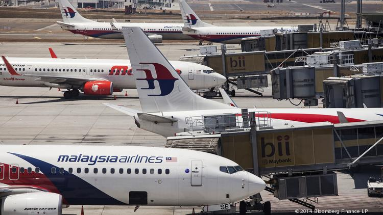 Malaysian Airline System Bhd. aircraft stand on the tarmac at Kuala Lumpur International Airport in Sepang, Malaysia, in March of 2014.