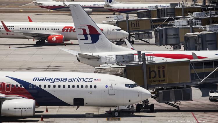 Malaysian Airline System Bhd. aircraft stand on the tarmac at Kuala Lumpur International Airport in Sepang, Malaysia, on Tuesday.