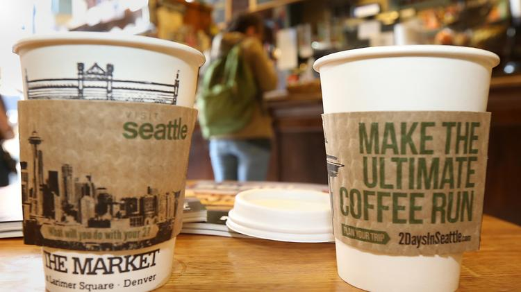 Visit Seattle, the city's visitor's bureau, gave away free coffee in Denver and Salt Lake City on Monday to promote tourism to the city.