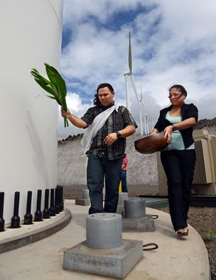Kahu Dane Maxwell and his wife, Jennifer, are seen leading a Hawaiian blessing for each of the eight turbines on the the Auwahi Wind facility at Ulupalakua Ranch on Maui, in this February file photo. Sempra U.S. Gas & Power has proposed expanding the wind farm by adding an additional 40 turbines.