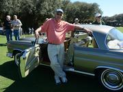 Larry Ledbetter of Alexandria Va., and his 1966 Mecedes 250 SE Coupe on the fairway of the Ritz Carlton Amelia Island at the Coffee and Cars show.