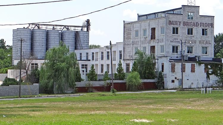 Prospect Brands, the owner of Gerbing's and Duckhead, plans to move its headquarters to this site, the former North State Milling Co., on South Elm Street just south of Lee Street. The company also plans a retail store.