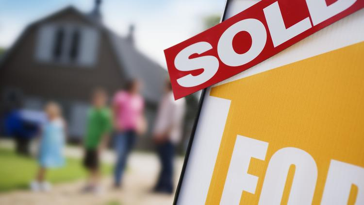 The National Association of Realtors says existing home sales in March were 0.2 percent lower than February and down 7.5 percent from a year ago.