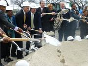 Mayor Vincent Gray breaks ground on the Skyland Town Center on Wednesday, March 12, 2014. To Gray's right is Chris Smith, Gary Rappaport, Carrie Thornhill and Merrick Malone. To Gray's right are Council members Yvette Alexander, Jack Evans, Kenyan McDuffie and Anita Bonds.