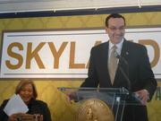 Mayor Vincent Gray cracks a smile during the Skyland Town Center groundbreaking. Councilwoman Yvette Alexander, D-Ward 7, is seated.