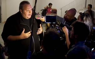 Kim Dotcom, founder of Megaupload.com, speaks to members of the media during the launch of the company's new website Mega at his mansion in Coatesville, near Auckland, New Zealand, on Sunday, January 20, 2013. Dotcom, marking one year since his Megaupload.com website was shut down by the U.S. Department of Justice and his home raided by New Zealand tactical squad officers in helicopters, unveiled his new website Mega, a successor file-storage and sharing site, saying innovation won't be stopped.