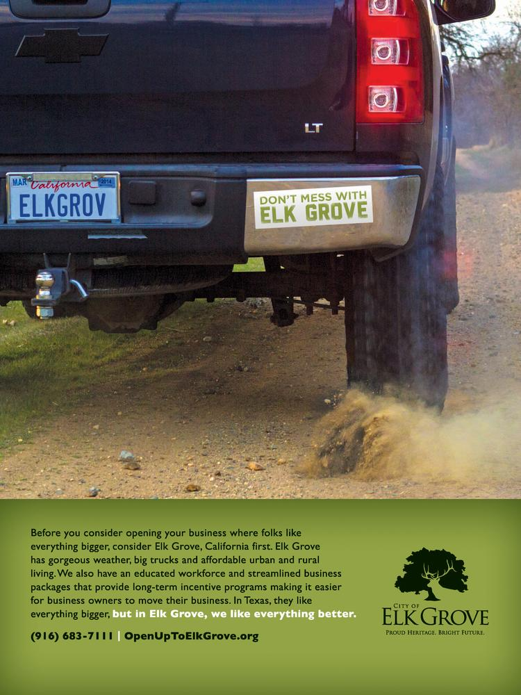"Right back at you, Texas! An advertisement placed in the Houston Business Journal depicts a Chevy Silverado rolling through a dirt road with an ELKGROV custom license plate and a bumper sticker that warns ""Don't Mess With Elk Grove."" In the small print? ""In Texas, they like everything bigger, but in Elk Grove, we like everything better."""