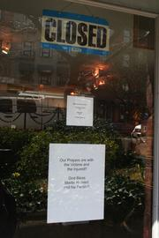A sign at The Closet, a used clothing store, telling customers they are closed due to the tragedy on Monday.