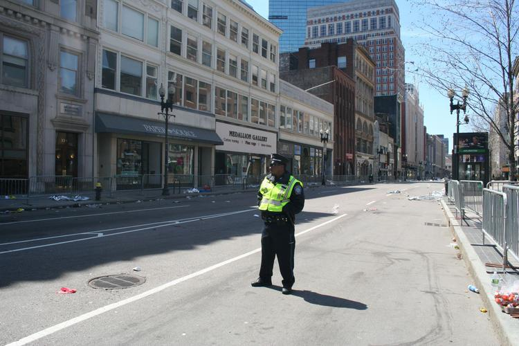 Looking up a desolate Boylston Street from Arlington Street as pedestrians and vehicles are off limits.