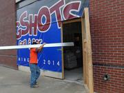 Work is underway at a Mugshot Grill and Bar in Uptown.